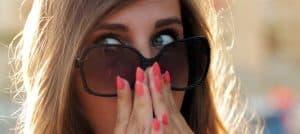 fake tan remover woman hiding face